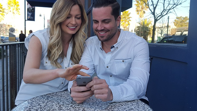 couple with phone smiling